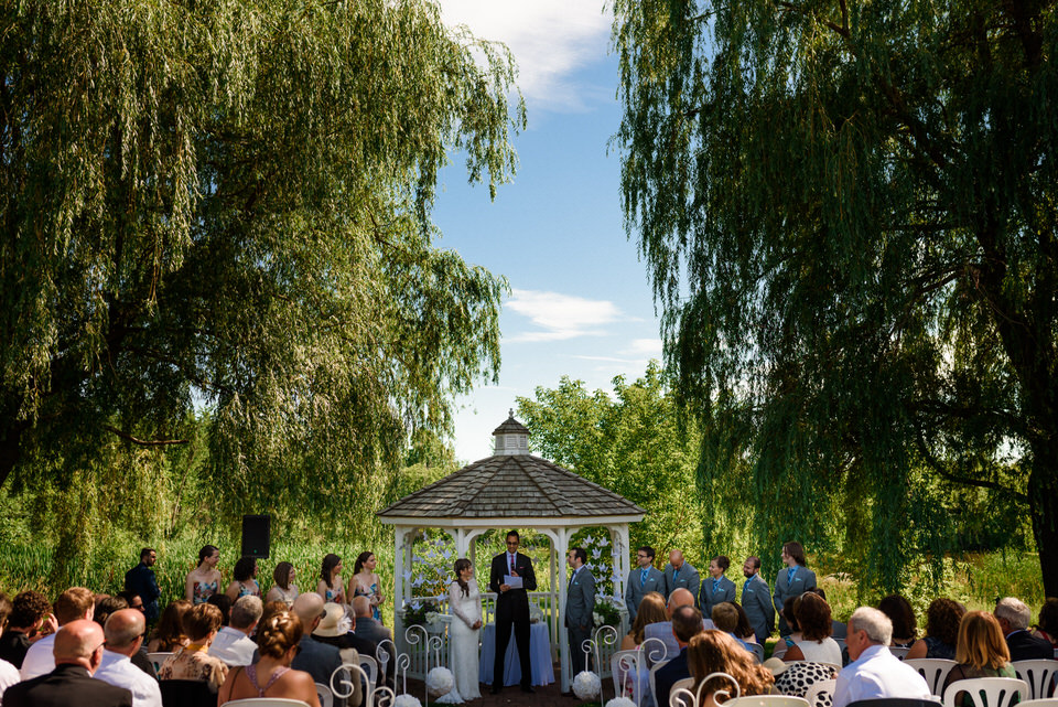 Outdoor wedding ceremony in front of gazebo at Auberge des Gallant