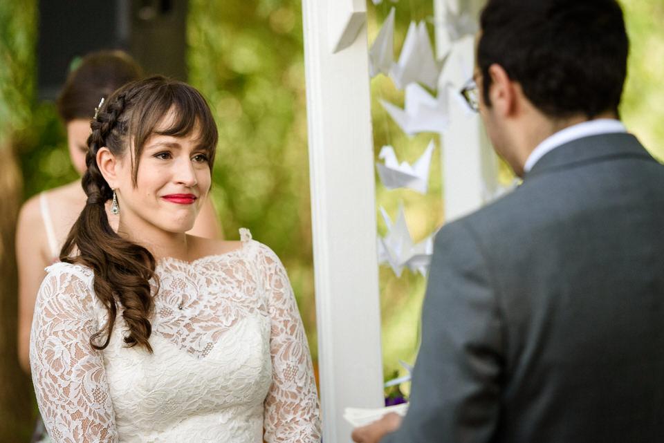 Emotional bride during wedding vows