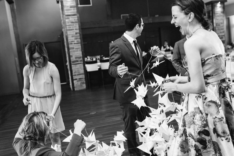 Team effort: Friends untangle the origami crane backdrop