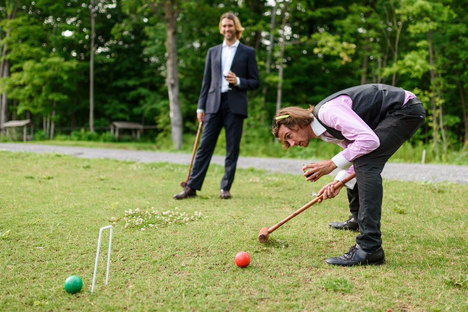 Two wedding guests playing croquet