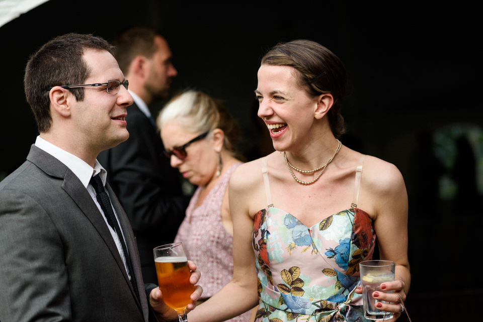 Guests laughing together during cocktail hour