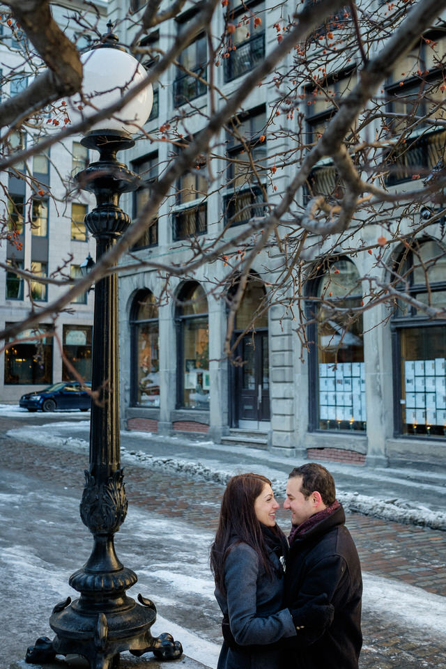 Couple hugging happily in old Montreal port