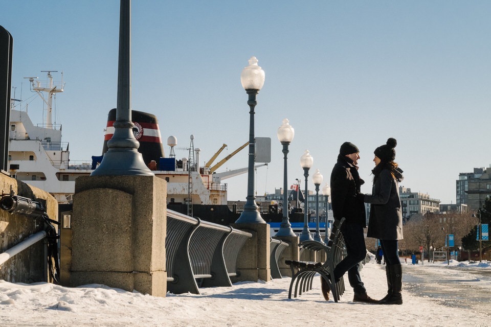 Couple holding hands in the old Montreal port