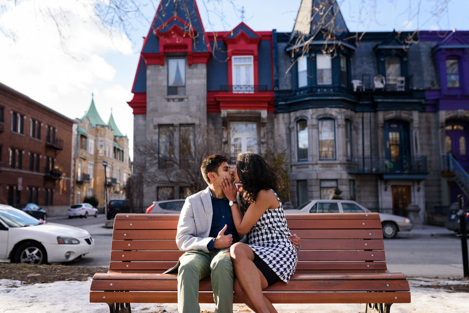 New fiances kissing on park bench at Carre Saint Louis