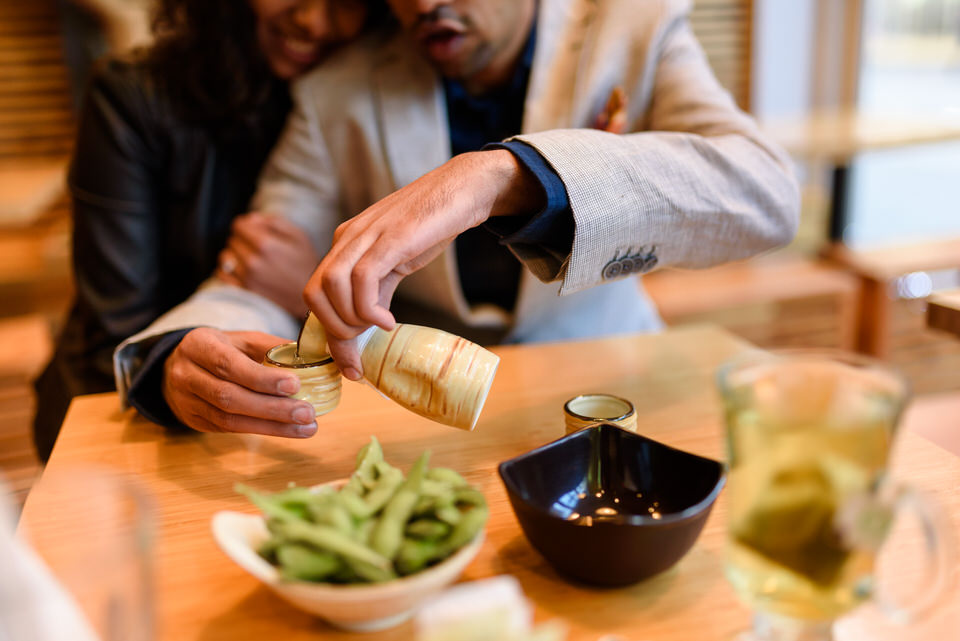 Couple pouring sake