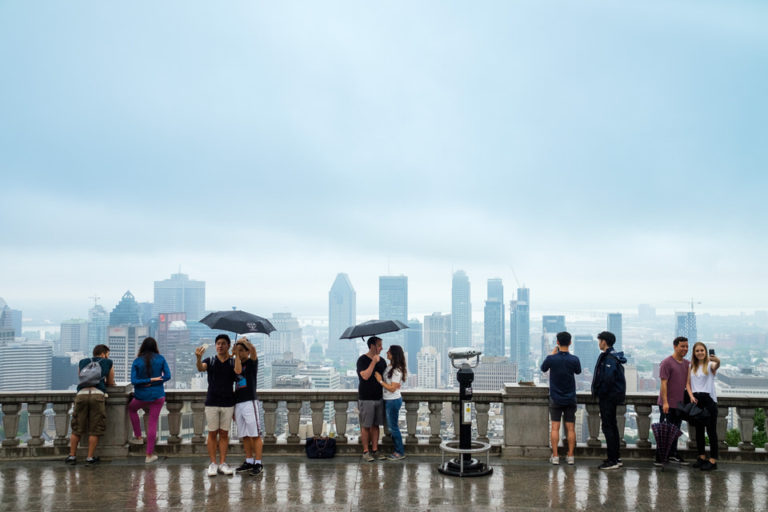 Rainy day surprise proposal on Mount-Royal