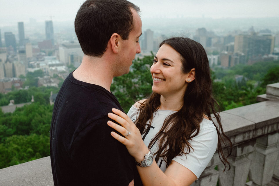 Engaged couple hugging at the Montreal lookout