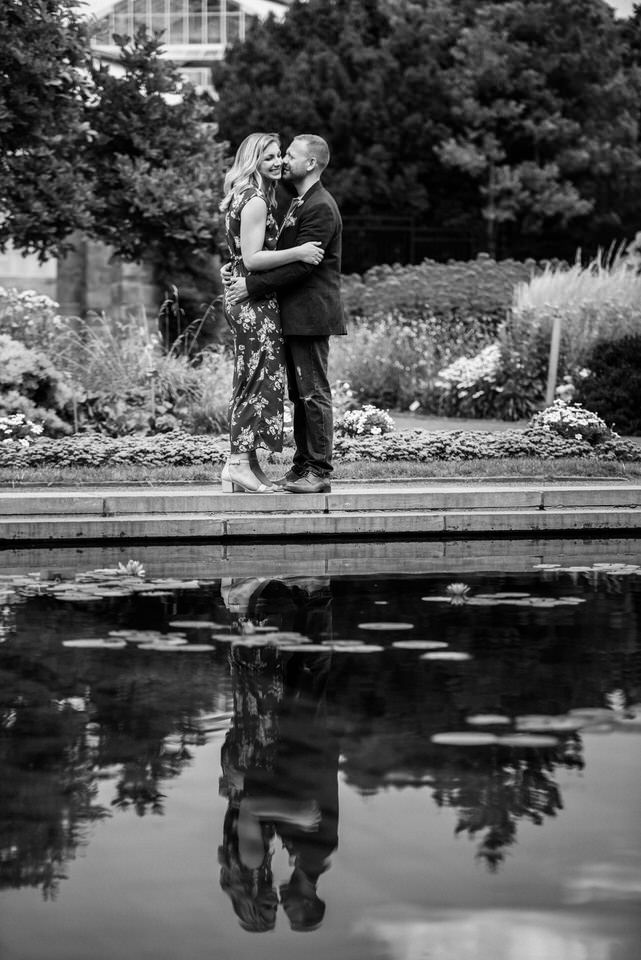 Reflection of a couple in a pond