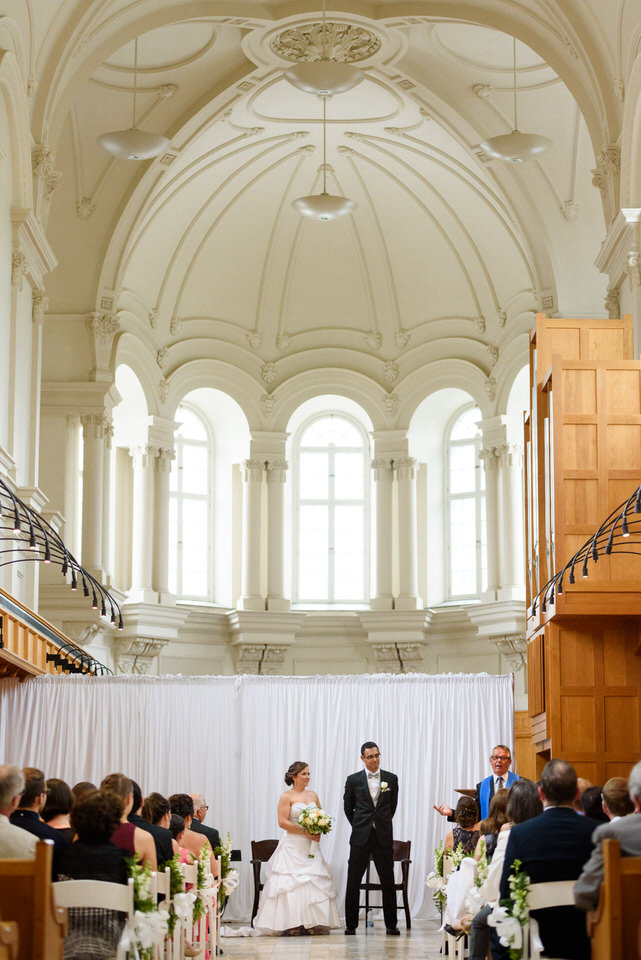 Abbaye d'Oka wedding ceremony with beautiful arching ceiling