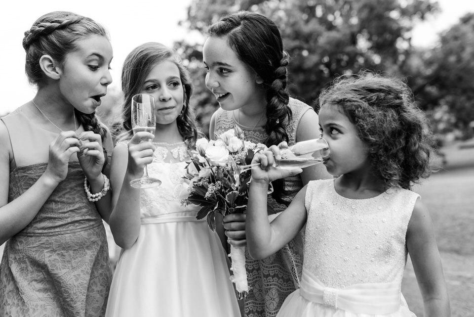 Black and white candid photo of children at Abbaye Oka wedding