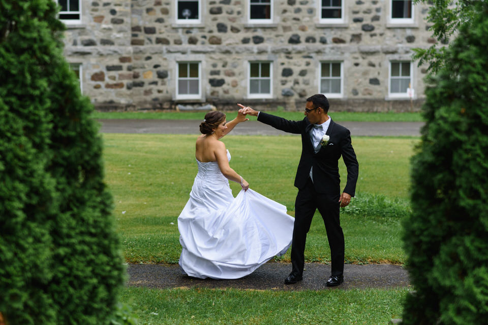Wedding couple dancing on the grounds of the Abbaye d'Oka