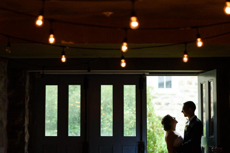 Silhouette of bride and groom in doorway