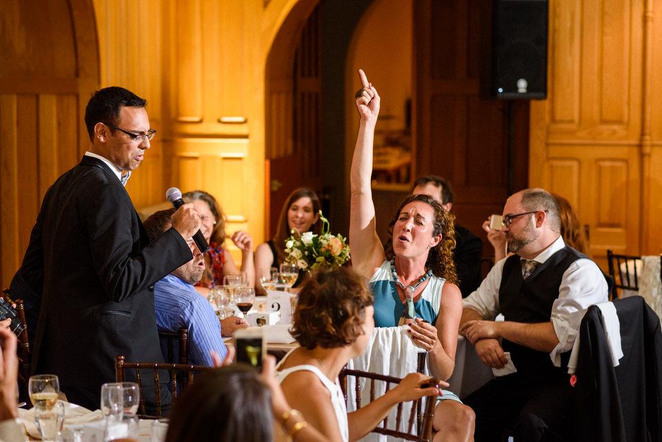 Groom singing karaoke and wedding guest singing along