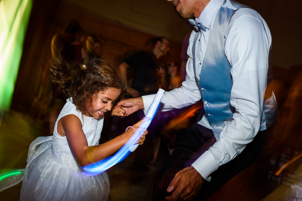 Flower girl dancing with her dad