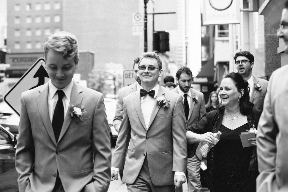 Groomsmen walking together downtown