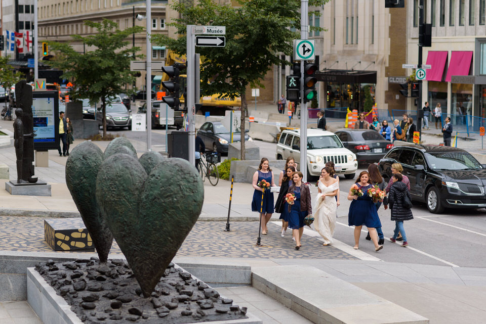 Bride and her bridesmaids walking in Montreal streets