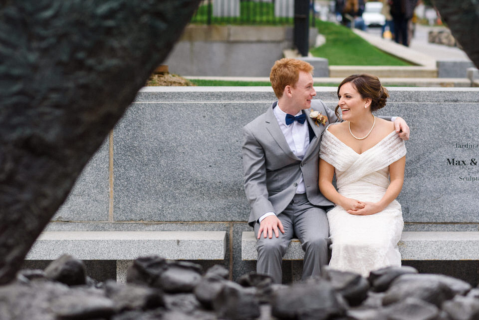 Newlyweds sitting in front of Montreal museum of fine arts