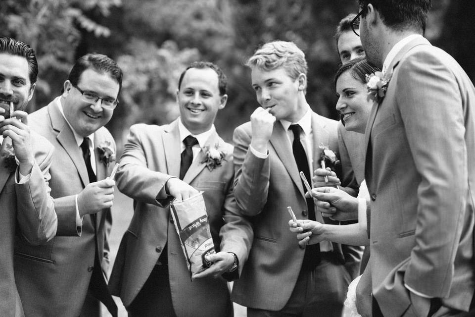 Groomsmen eating snacks before the wedding ceremony