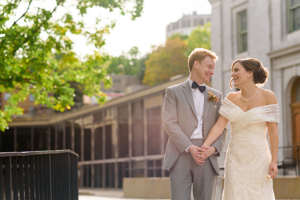 Newlyweds holding hands in the sun