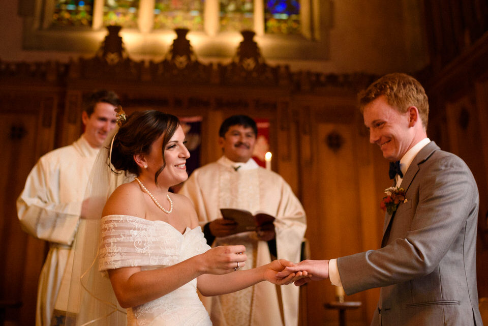 Wedding ring exchange in front of priest