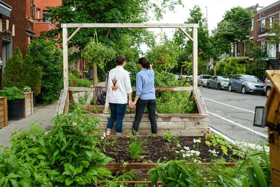 Gay couple exploring urban gardens in Montreal