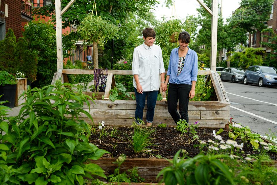 Gay couple exploring urban gardens in Little Italy