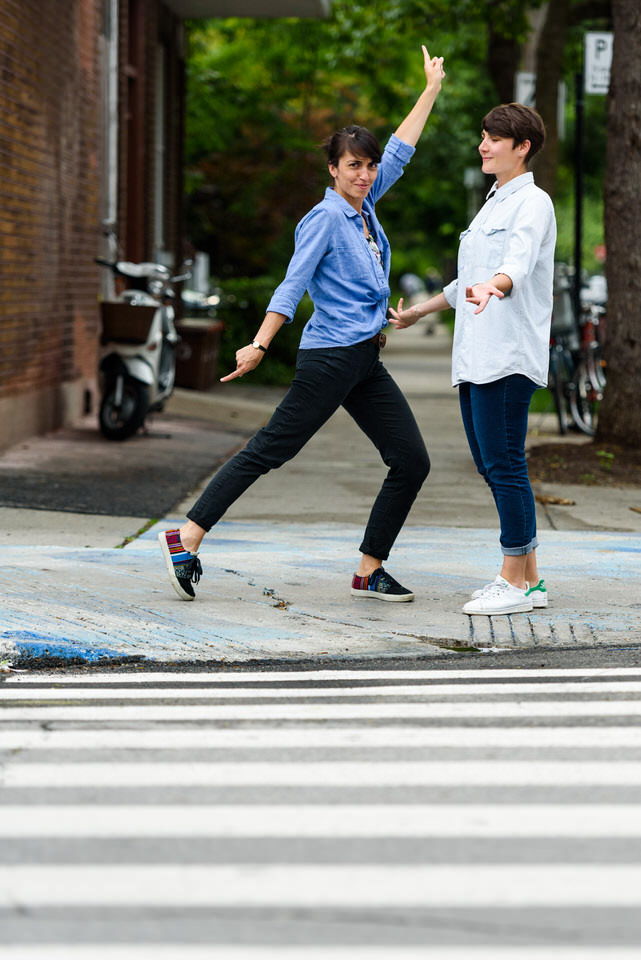 Striking a quirky pose during same-sex engagement photos