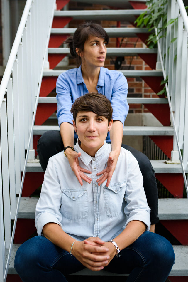 LGBT engagement photos on porch steps in Montreal
