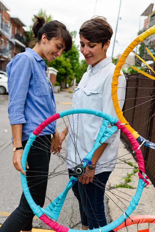 Same sex couple wandering backyard alleyways and exploring art pieces
