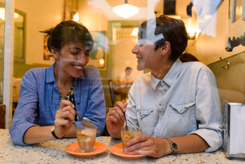 LGBT couple portraits at Cafe Ferlucci in Montreal