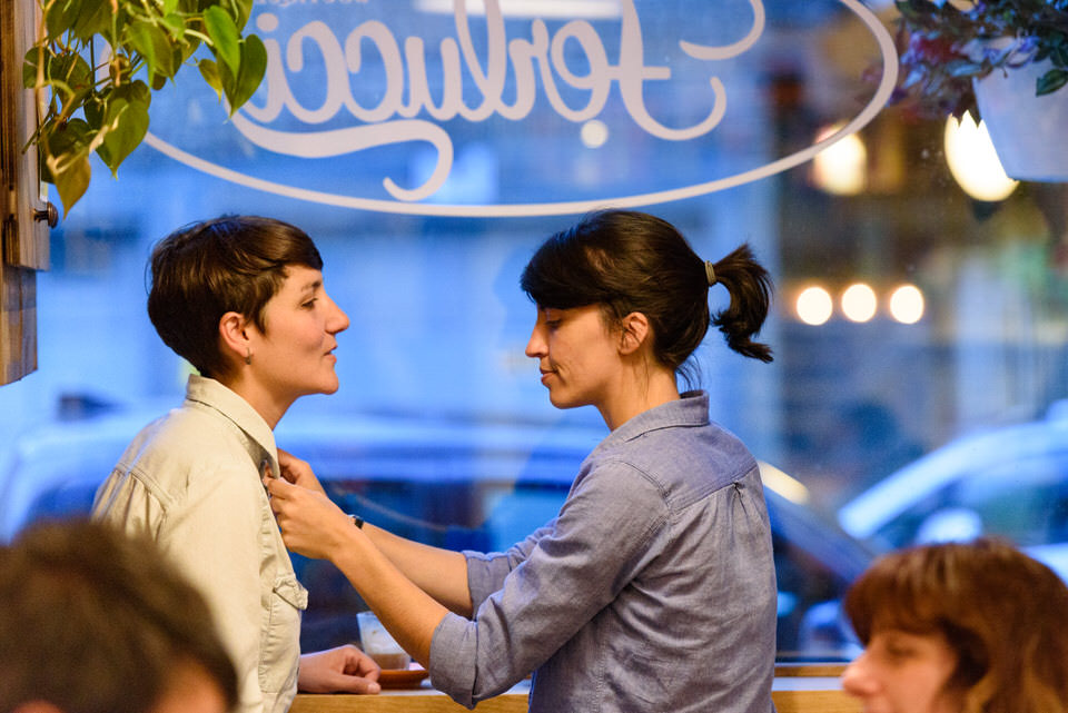 Romantic photo at Montreal cafe for lesbian couple