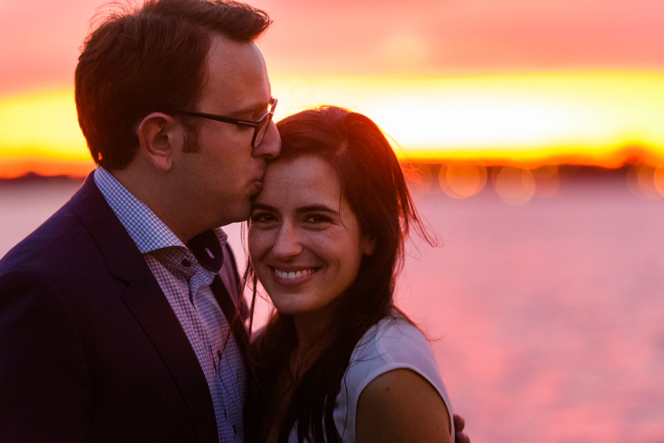 Newly engaged couple after sunset proposal