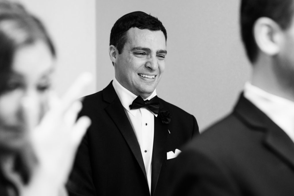Emotional wedding photo of the bride's brother crying during the wedding ceremony
