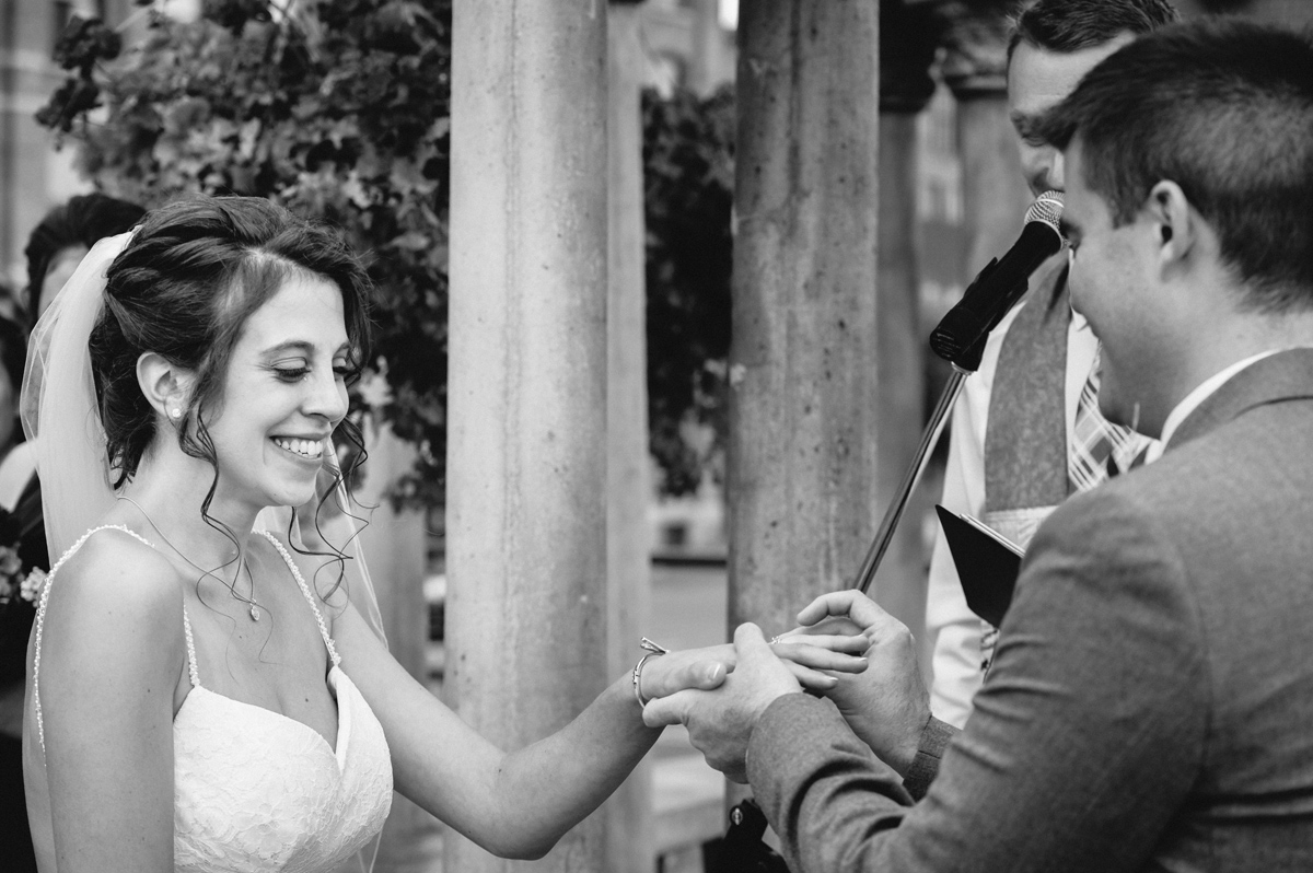 Wedding couple exchanging rings at gazebo wedding ceremony