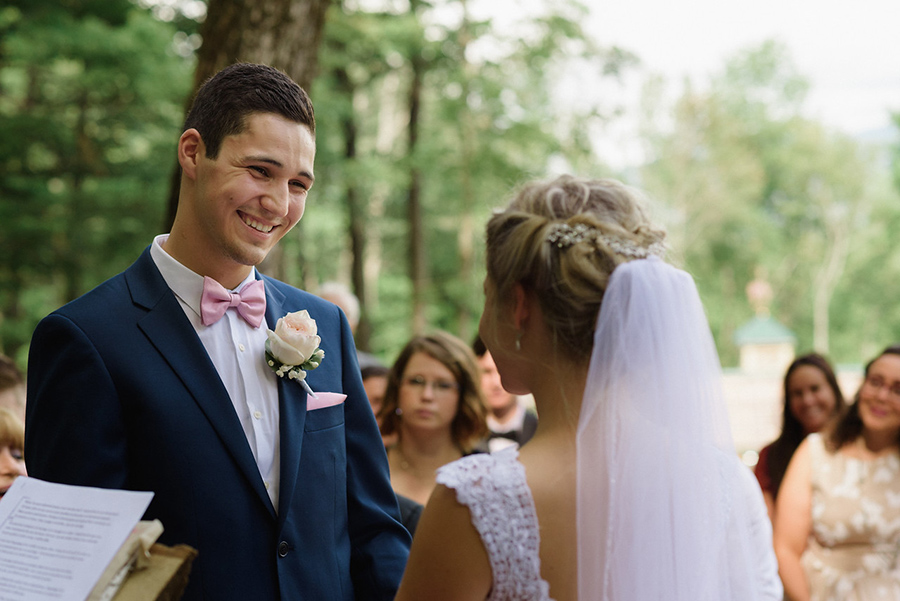 Groom's face looking at bride during wedding ceremony