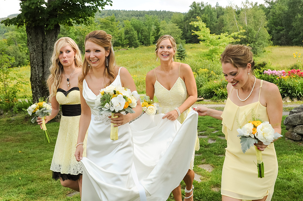Bride and bridesmaids walking to wedding ceremony