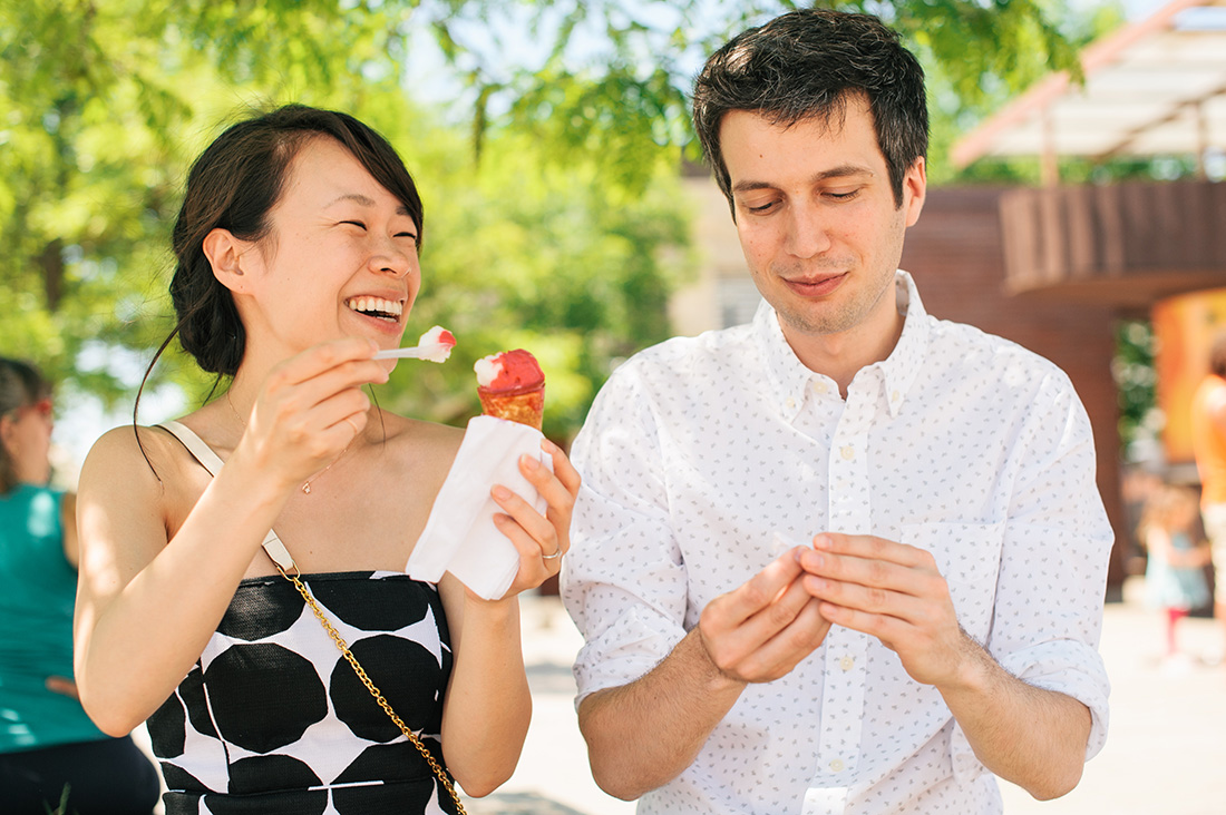 Couple enjoying ice cream during summer engagement photos