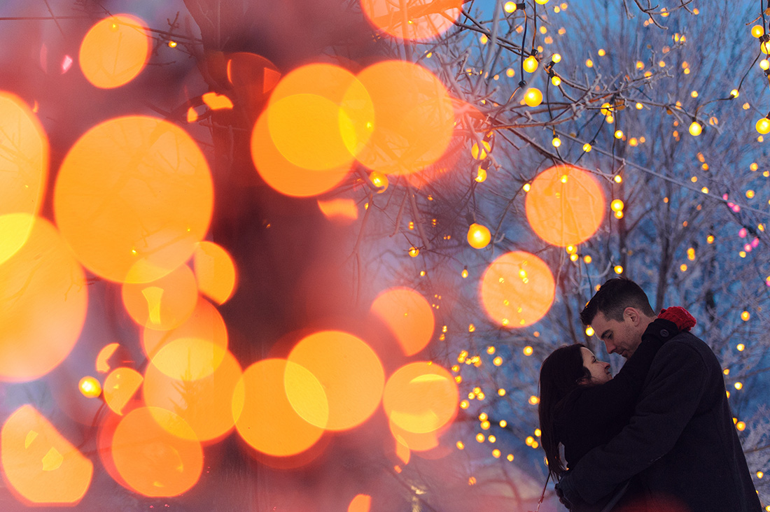 Winter engagement photo with bokeh at Beaver Lake