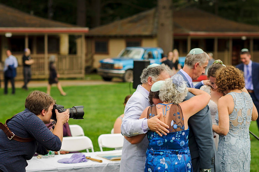 Photojournalistic wedding photographer at work - Photo: Jackie Ricciardi