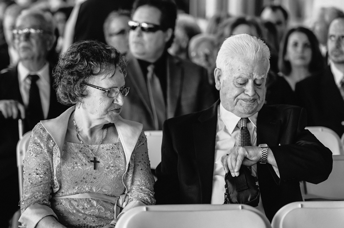 Award-winning wedding photo of grandparents looking at watch