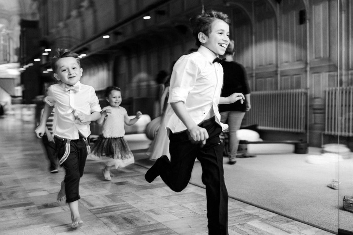 Award-winning wedding photo of kids running