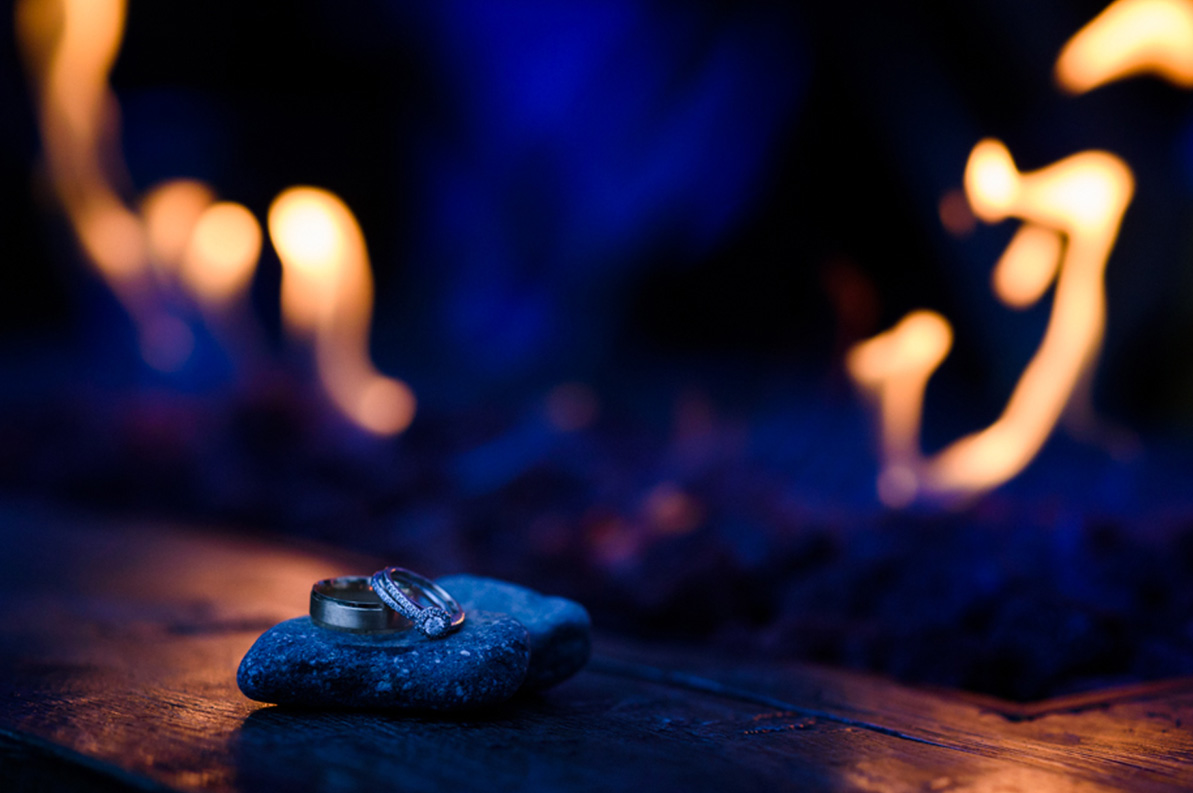 Wedding rings near a fireplace