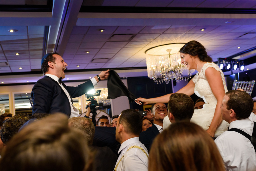 Wedding couple lifted in chairs at Le Challenger, Montreal