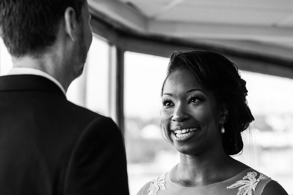 Emotional wedding ceremony photo on boat in Quebec City