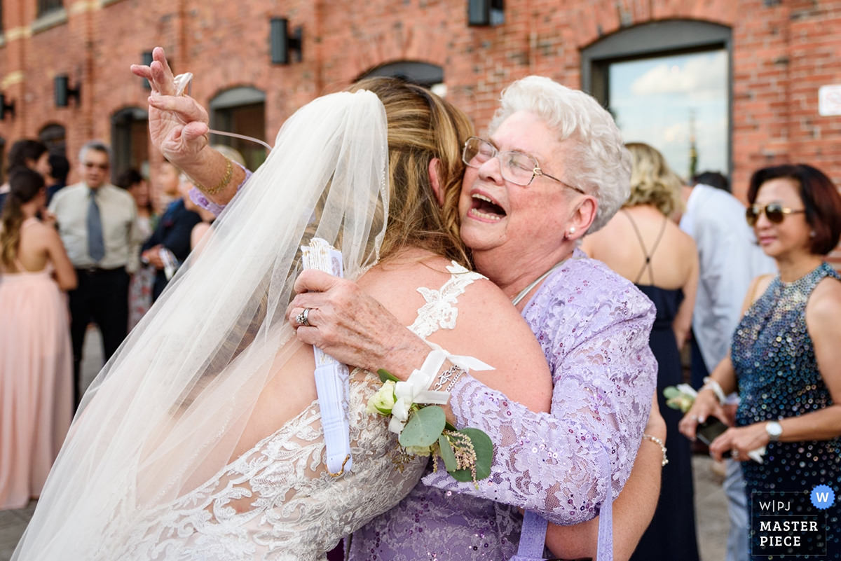 Award winningweddingphotoofbride'semotionalgrandmother