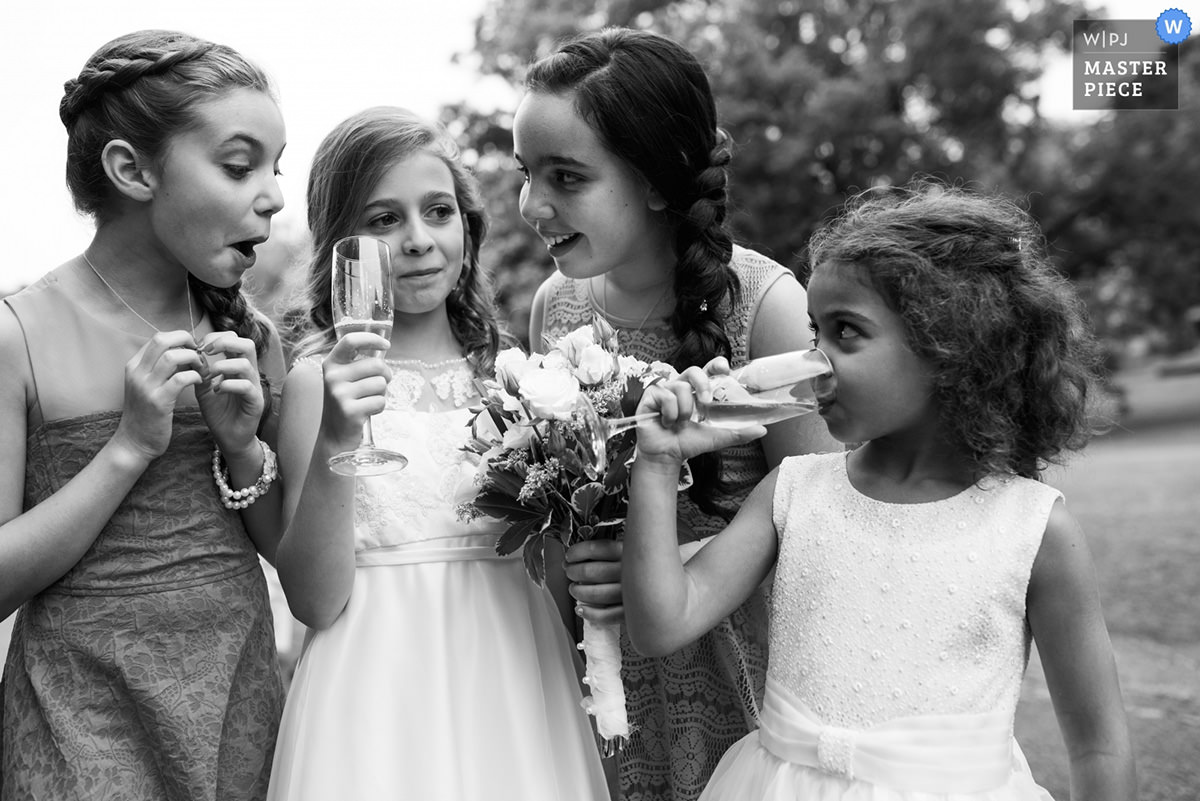 Award-winning wedding photo of kids drinking out of champagne flutes