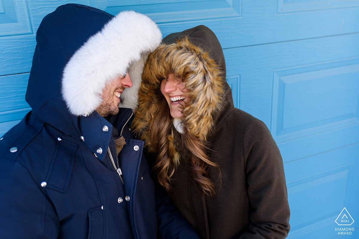 Award-winning engagement photo of couple in furry hoods