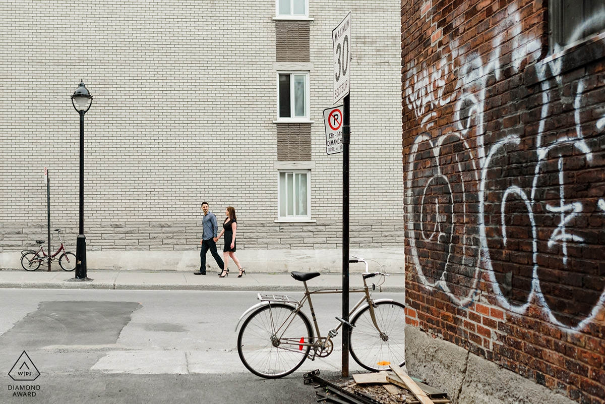 Award-winning engagement photo of couple walking around Saint-Henri