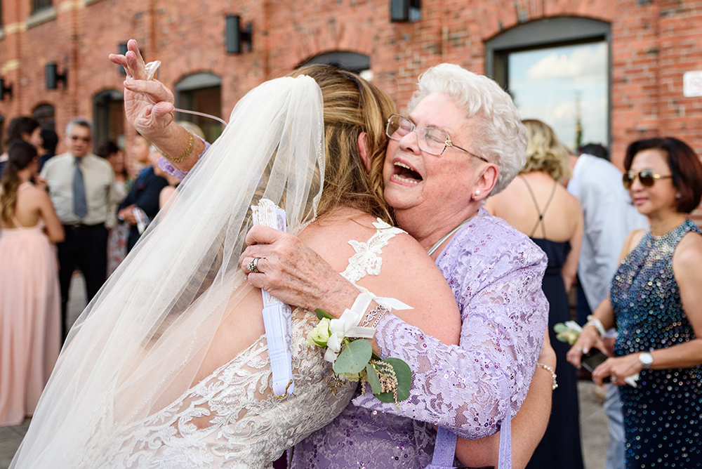 Grandmother hugging the bride