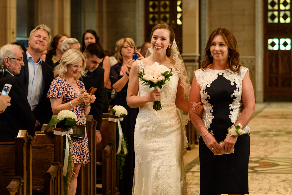 Bride and her mom walking up to front of church
